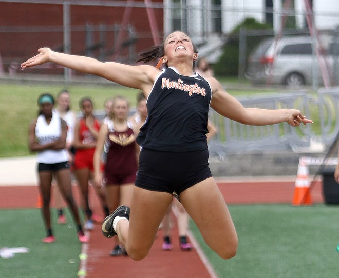 Marlington's Calli Swisher competes in the long jump at last week's Division II district meet in Salem.