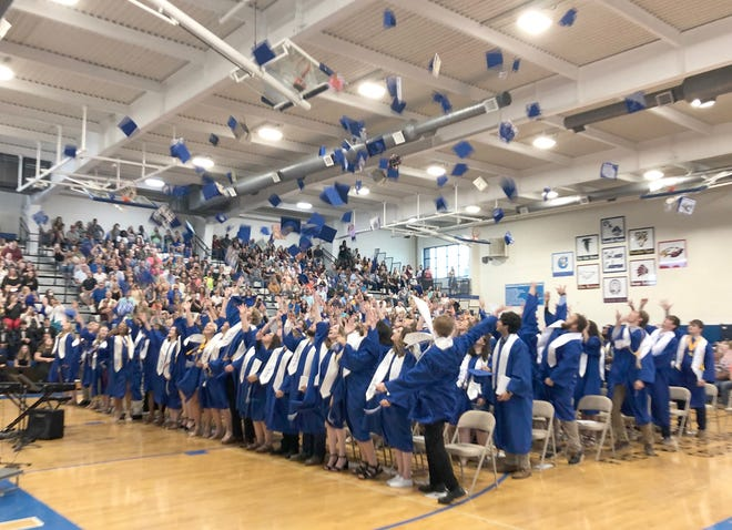 The Boonville Class of 2021 throw their caps in the air at the conclusion of commencement Sunday at the Windsor gymnasium at Boonville High School.