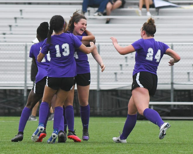 Grizzly teammates swarm freshman Ellie MacDonald (#4, middle) after scoring a goal in the 74th minute against Hutchinson in Saturday's Region VI semifinal at Wichita's Stryker Sports Complex.