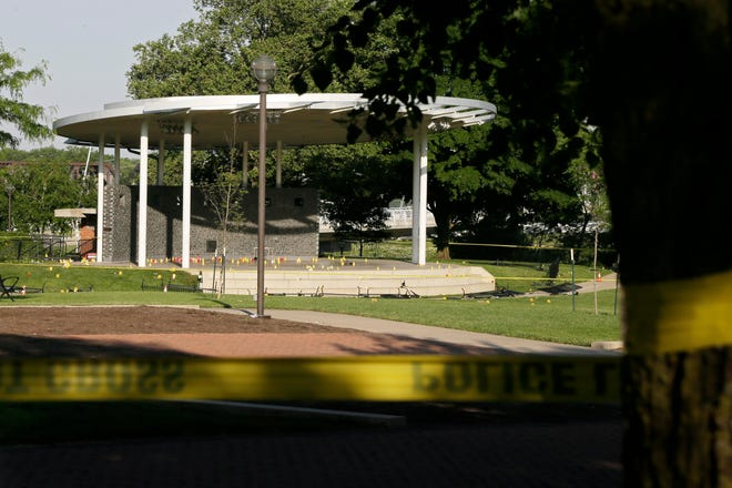 Crime scene tape surrounded Bicentennial Park Downtown as Columbus police investigated a mass shooting on May 22. The city has had 100 homicides so far this year.