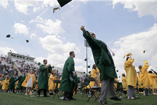 Ethan Cramblit tosses his cap at the end of Hamilton Township High School's graduation for the Class of 2021 at Fortress Obetz on Sunday.