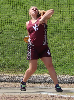 John Glenn freshman Chelsea Sotherden competes in the discus during Saturday's Division II district track meet at Meadowbrook High School. Sotherden finished runner-up in both the shot put and discus to advance on to Division II regional action next week.