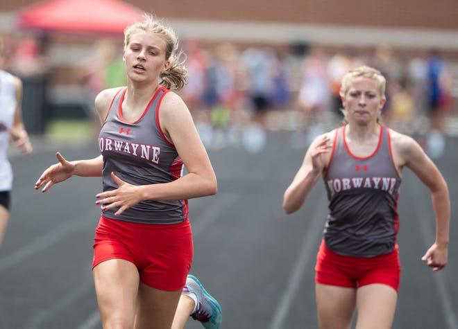 Norwayne's Jaylee Wingate (left) crosses the 400 meter finish ahead of teammate Lacy Hess.