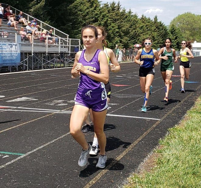 Blissfield's Mari Cueto runs during the 1,600 at the Division 3 regional at Sand Creek.