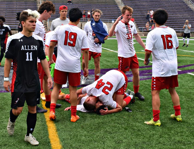 Southeastern Community College's Joep De Bruin (24) pins a teammate in jubilation after the Blackhawks won the Plains District Division II soccer championship at Bracewell Stadium Saturday. SCC ousted Allen (Kansas), 2-1, and advances to the national tournament June 5-10 in Wichita, Kansas.
