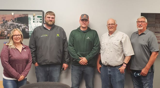 Newly-elected board members to the Atkinson Village Board were seated at a recent regular meeting. They are Sarah Combs, Travis Vandersnick and John Skinner. Board member Ryan Rahn, fourth from left, and Mayor Ken Taber also were re-elected to the board.