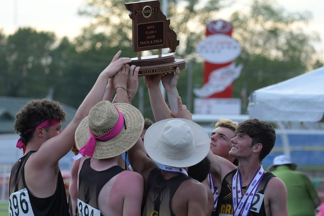 The Green City boys track team hoists its Class 1 state title on Saturday following the 2021 MSHSAA State Track Championships.