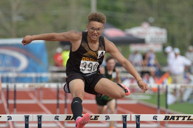Green City freshman Asher Buggs-Tipton clears his last hurdle during the 300m hurdles race at the 2021 MSHSAA State Track Championships.