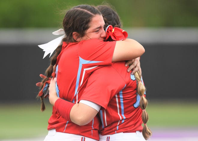 Monterey's Makenna Sandoval, left, hugs senior Claire Decker after falling to Justin Northwest in Game 3 of their Region I-5A semifinal series Saturday, May 22, 2021, at Abilene Christian's Poly Wells Field in Abilene.