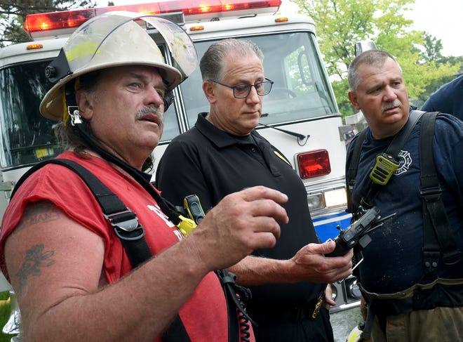 Village of Dundee Police Chief Kent Jeppesen shows the hot spots from the drone flying over the Village Pointe Apartments where Dundee Assistant Chiefs Rob Justice (left) and Ron Charter had been battling an apartment blaze since 4:30am Sunday, May 23, 2021.