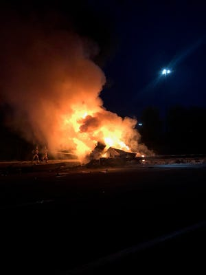 A tractor trailer rolled over and burst into flames on Interstate 95 southbound in Kittery early Sunday morning, closing the southbound lanes of the highway for several hours.