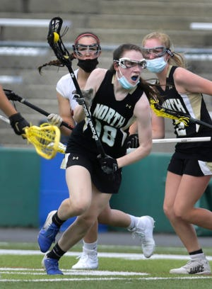 The Cranston West Falcons take on the visiting Skippers of North Kingstown in girls lacrosse on Sunday afternoon at Cranston Stadium.  [The Providence Journal / Kris Craig]