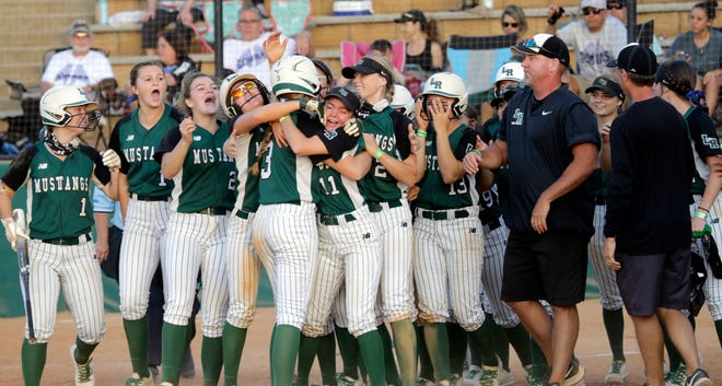 The Lakewood Ranch High softball team celebrates its first state title following a 14-4 win over Lake Worth Park Vista in the Class 7A state final Saturday night at Legends Way Ballfields in Clermont.
