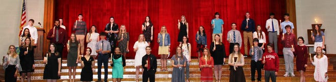 Meyersdale Area High School hosted its annual National Honor Society induction ceremony on May 17. Because of the school closure in spring 2020, a ceremony was not held to honor 2019-2020 inductees. As a result, inductees from this year and last were recognized at this event. Students participating in the traditional ceremony from left, front row: Elizabeth Sayler, Lakyn Lear, Kaylee Karlie, Miranda Yacynych, Trevor Donaldson, Kendal Sigler, KeriAnn Beard, Kylie Sipple, Noah Wilt and Lydia Renzi. Second row: Karaha Snyder and Melanie Reither. Third row: Jillian Bako, Jaden Blough, Gabe Kretchman, Ally Hetz, Paige Gnagey, Laken Hat and Dawson Rough. Fourth row: Evan Thomson,  Jalen Stephens, Hannah Yoder, Karlee Witherite, Lauren Kretchman, Maddie Faner, Brycen Sechler, Tara Knopsnyder, Ethan Simpkins and Faith Decker. Back row: Olivia Miller, president; Briar Sheetz, Alix Tipton, Abbigail Benning, Abigail Shuck, Samuel Hughes, Brennan Campbell, Dylan Shilling and Evan Schafer.