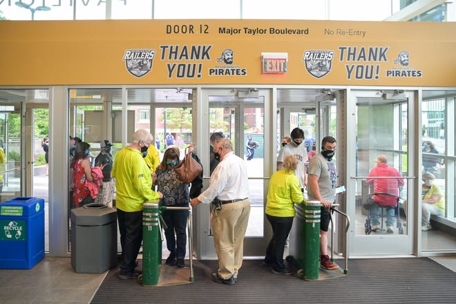 Fans enter the DCU Center for a Pirate's game Friday.