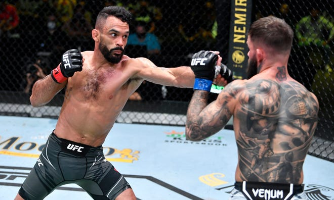 Rob Font punches Cody Garbrandt in their bantamweight bout during the UFC Fight Night event at UFC APEX on May 22, 2021 in Las Vegas, Nevada.