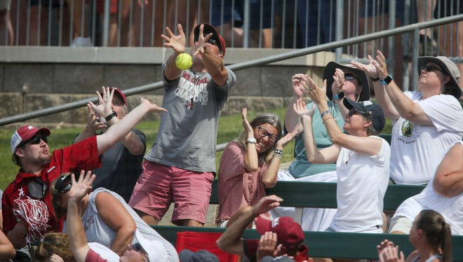 A foul ball almost turns a fan into a hero in Rhoads Stadium in Tuscaloosa, Ala., during the Tuscaloosa Regional championship between Alabama and Clemson Sunday, May 23, 2021. Alabama won the game 5-0. [Staff Photo/Gary Cosby Jr.]