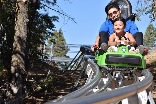 A young girl steers a Mineshaft Coaster cart around the track at Alpine Slide Big Bear in Big Bear Lake in an undated photo. The new attraction is the first and only mountain coaster in California.