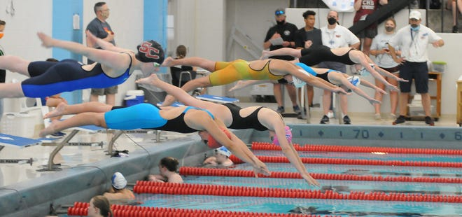 Salina Central's Olivia Moore (from left), Wellington's Jensen Lynnes, Winfield's Emma Moore, McPherson's Danica Brunk, Andover High School's Reagan Bayliff, and Wichita Collegiate's Katherine Grace dives in to start the 100-year freestyle in the Ark Valley Chisholm Trail League Division II-IV Championships at Salina South natatorium on Friday. McPherson's Danica Brunk finished in first place with a time of 53.03.