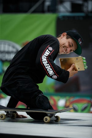 Felipe Nunes reacts after winning both the men's adaptive park and street competitions at the Dew Tour Des Moines at the Lauridsen Skatepark on Sunday.