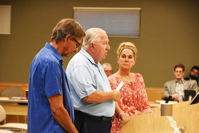Bob Roth, from left, Mick Moriarty and Erin Mia Milchman present a layout for handicapped accessibility beach matting to City Council. The council met on May 17.