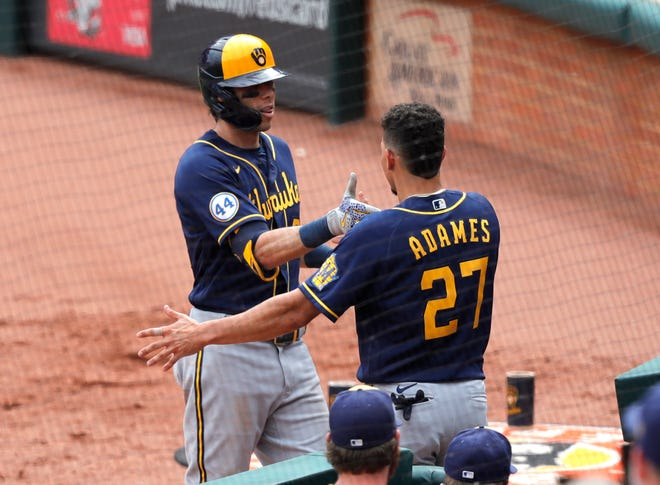Willy Adames agreets Christian Yelich after his solo home run in the ninth inning.