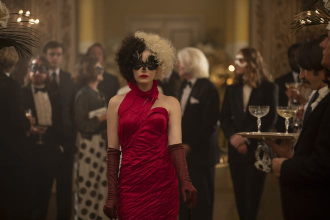 """A young fashion designer (Emma Stone) goes over the edge on her way to supervillainy in """"Cruella."""""""