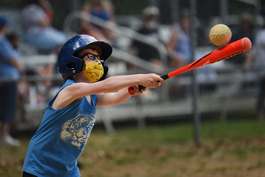 Ben Hoffman,8, tries to connect with a baseball ball during the second day of Rally Cap Sports, which is a youth sports organization that creates programs for kids with special needs at Lincroft Elementary School in Lincroft on 05/23/21.