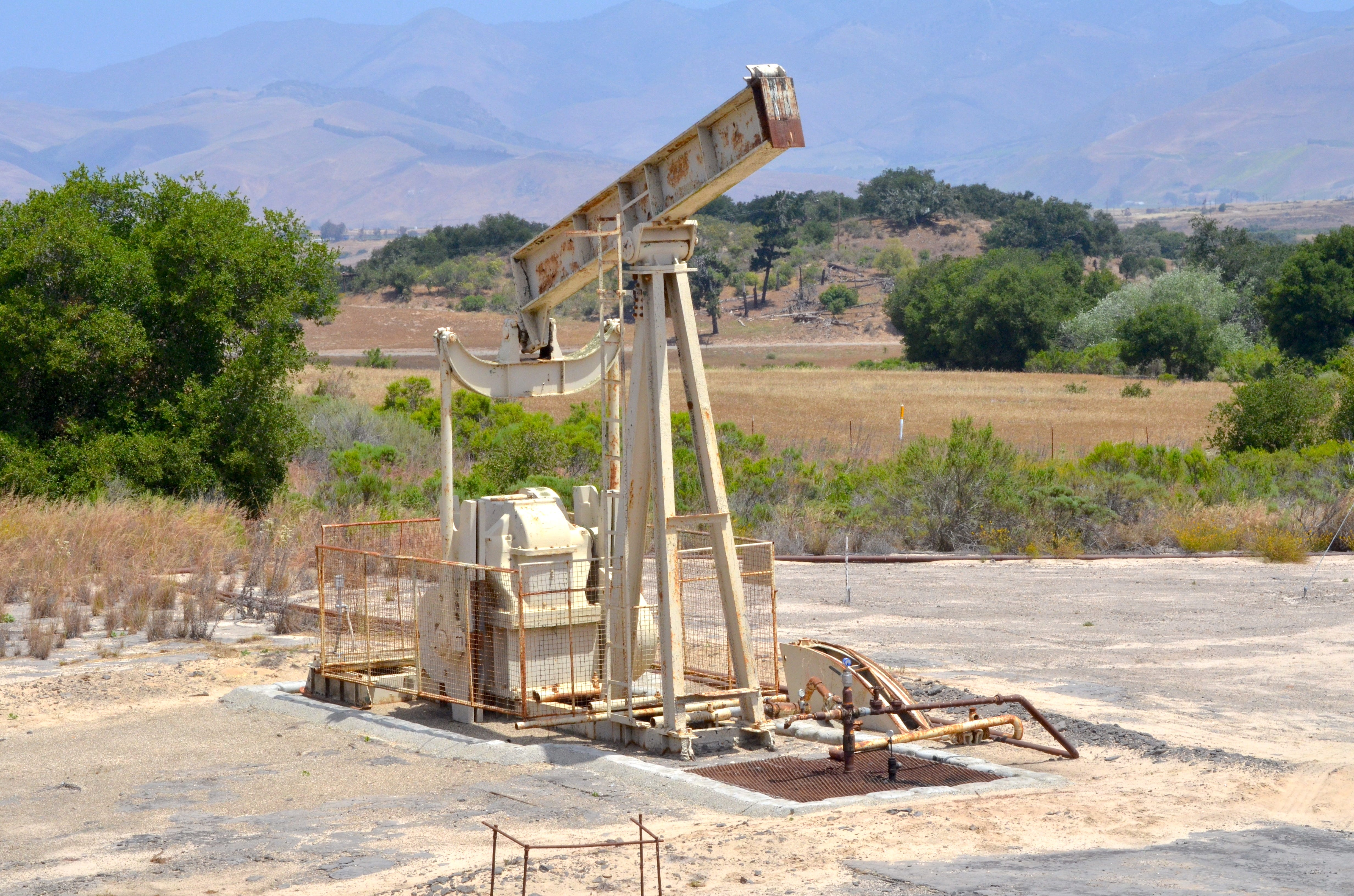 A pump jack sits idle and rusting in the Cat Canyon oil field, where Randeep Grewal's former company, HVI Cat Canyon, entered bankruptcy and left hundreds of oil wells idle.