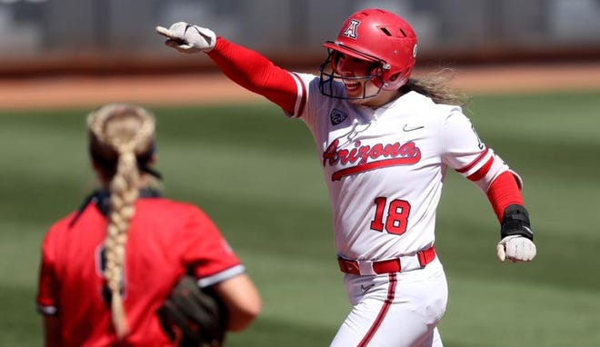 Arizona's Sharlize Palacios rounds second base after belting a grand slam during the second inning of Saturday's game. The blast staked the Wildcats to an 8-0 lead.
