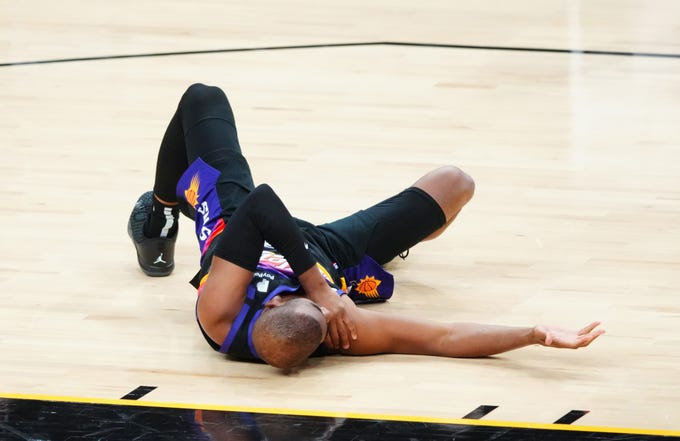 Phoenix Suns guard Chris Paul reacts after suffering an injury against the Los Angeles Lakers in the first half during game one in the first round of the 2021 NBA Playoffs. at Phoenix Suns Arena.