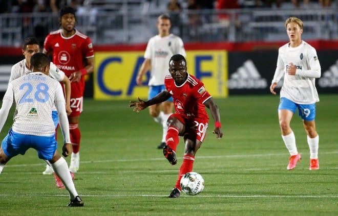 May 22, 2021; Phoenix, Arizona, USA; Phoenix Rising's Solomon Asante (20) passes against the Las Vegas Lights during a game at Phoenix Rising Stadium. Patrick Breen-Arizona Republic
