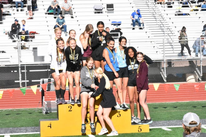 The Pine View girls celebrate winning an event during the Desert Hills Invitational earlier this spring.