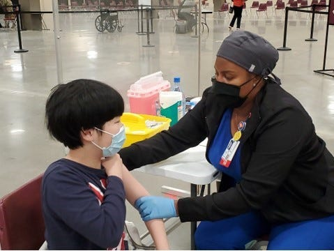 12-year-old Jin Joseph receives his first Pfizer COVID-19 vaccine shot May 14th at the Civic Center, administered by the Leon County Health Department.