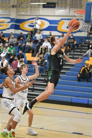 Jaden Benioff goes in for a layup during Thousand Oaks High's win over Newbury Park in the Marmonte League third-place tiebreaker game Saturday at Agoura High. The Lancers won 59-54 to qualify for the postseason.