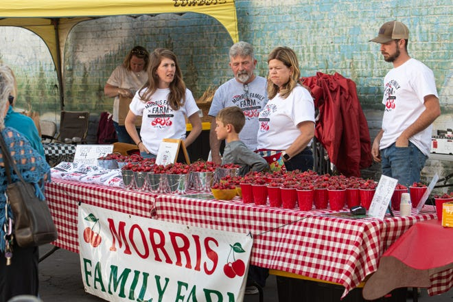The Cherry Festival Farmers Market brought hundreds of families to downtown Tulare on Friday. The event was organized by the Downtown Dream, a nonprofit that hopes to revitalize the district.