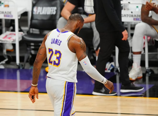 Los Angeles Lakers forward LeBron James reacts as he walks off the court in the closing seconds of a loss to the Phoenix Suns.