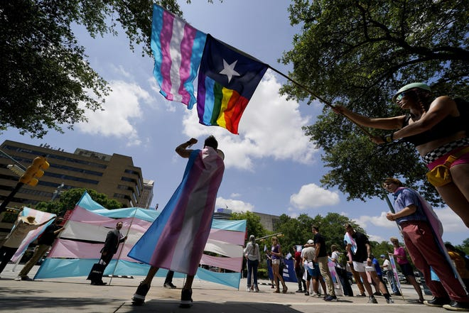 Demonstrators gather on the steps to the State Capitol to speak against transgender-related bills being considered in the Texas Senate and Texas House, Thursday, May 20 in Austin. [AP PHOTO/ERIC GAY]