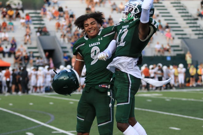 Ethan Davis celebrates a touchdown catch with Florida State commit and top ranked player in Georgia Travis Hunter on Friday night.