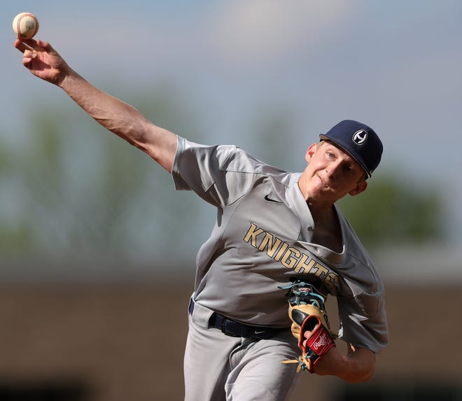 Archbishop Hoban starter Noah LaFine delivers a pitch in the second inning of an 11-1 win over Triway in a Division II district semifinal at Revere High School on Monday. [Jeff Lange/Beacon Journal]