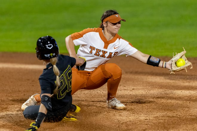 Oregon Haley Cruse beats the throw to Texas short stop McKenzie Parker during the Austin Regional game 6 in the NCAA softball tournament, Sunday, May 23, 2021.