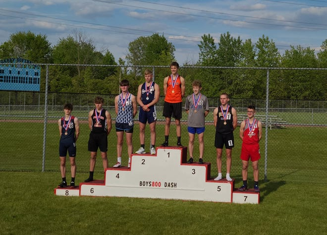 Ashland's Tyler Sauder stands on the podium after winning the 800 meters at theOHSAA 7th & 8th Grade Track and Field ChampionshipsatHilliard Darby High School on May 15.