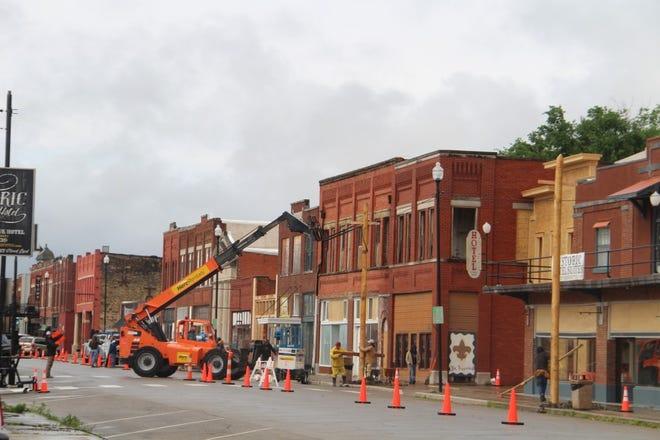 "Crews on Martin Scorsese's Apple Studios movie ""Killers of the Flower Moon"" work May 10 on Kihekah Avenue in Pawhuska."