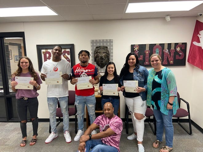 Revitalizing Our Community (ROC) awarded scholarships to Brownwood High School seniors. Brownwood High School principal Lindsey Smith and ROC representative LaJon Miller are pictured with scholarship recipients (from left) Preslee Maxfield, Khyren Deal, Royshad Henderson, Emely Mendoza and Amari Starr.