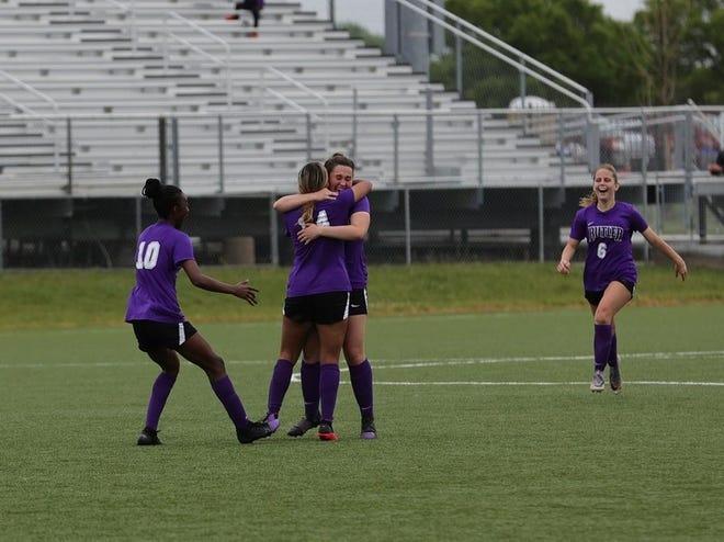 Butler soccer players celebrate a goal