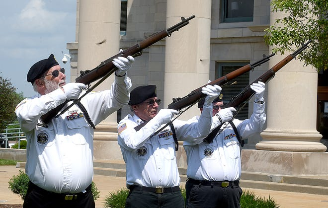 American Legion Post 202 Honor Guard members from left, Doug Garrett, Paul Hobbs, honor guard captain, and Melvin Bradley, commander elect, fire three volleys during the Memorial Day wreath-laying ceremony on Monday, May 24 at the Boone County Courthouse.