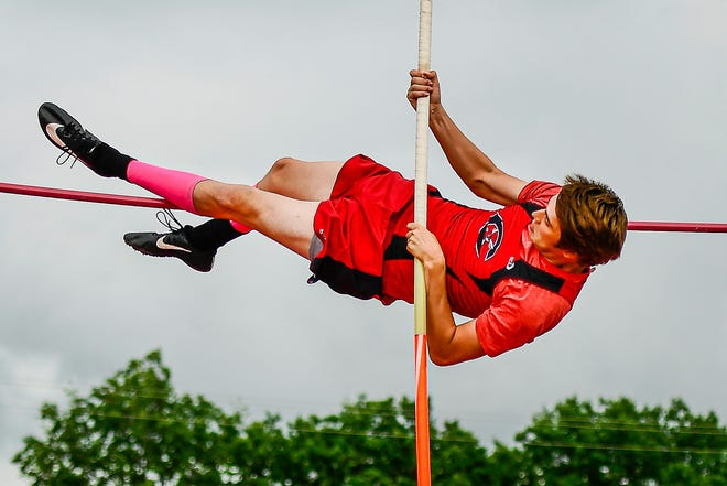 Chillicothe High School track-and-field Hornets senior Rudy Yutzy reaches the bar during one of his attempts during the pole vaulting competition during last Saturday's Class 3 sectional meet at Odessa. With a fourth-place finish, the recent CHS graduate advanced to today's state championship.