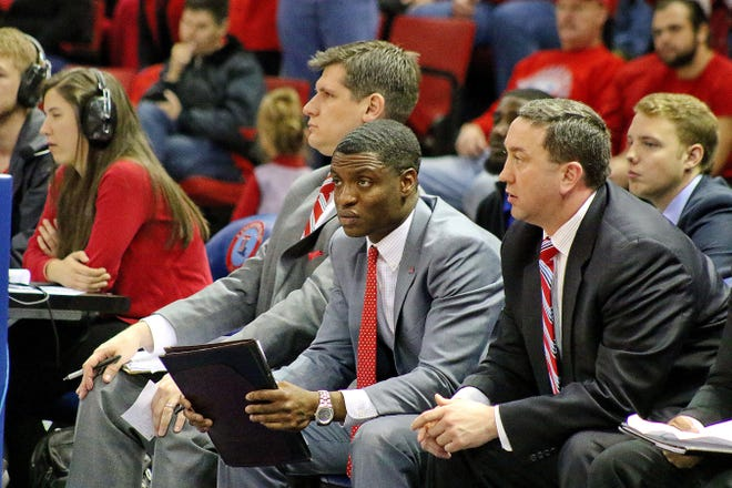 """Tony Skinn, center, coaching with Louisiana Tech. Said Tech coach Eric Konkol: """"He's just so connected to so many different people it's really remarkable."""""""