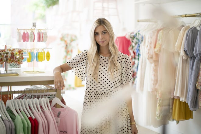 Stephanie Tersigni, owner of Jolie Occasions, says the foot traffic in the Short North drew her to put her boutique there. It's trickling back as activity ramps up at the nearby Greater Columbus Convention Center.
