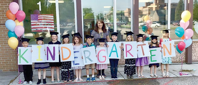 Teacher Teresa Cymbaluk is pictured with her Cathedral kindergarten class.